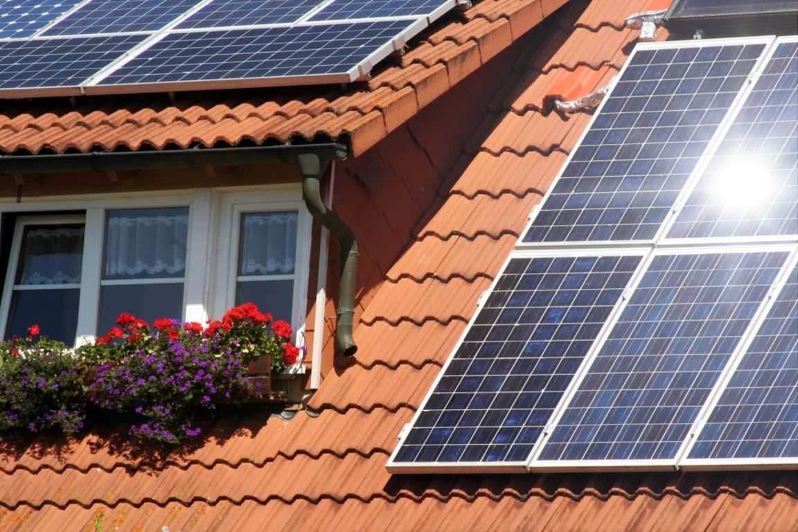 Housetop with solar panels and flowers
