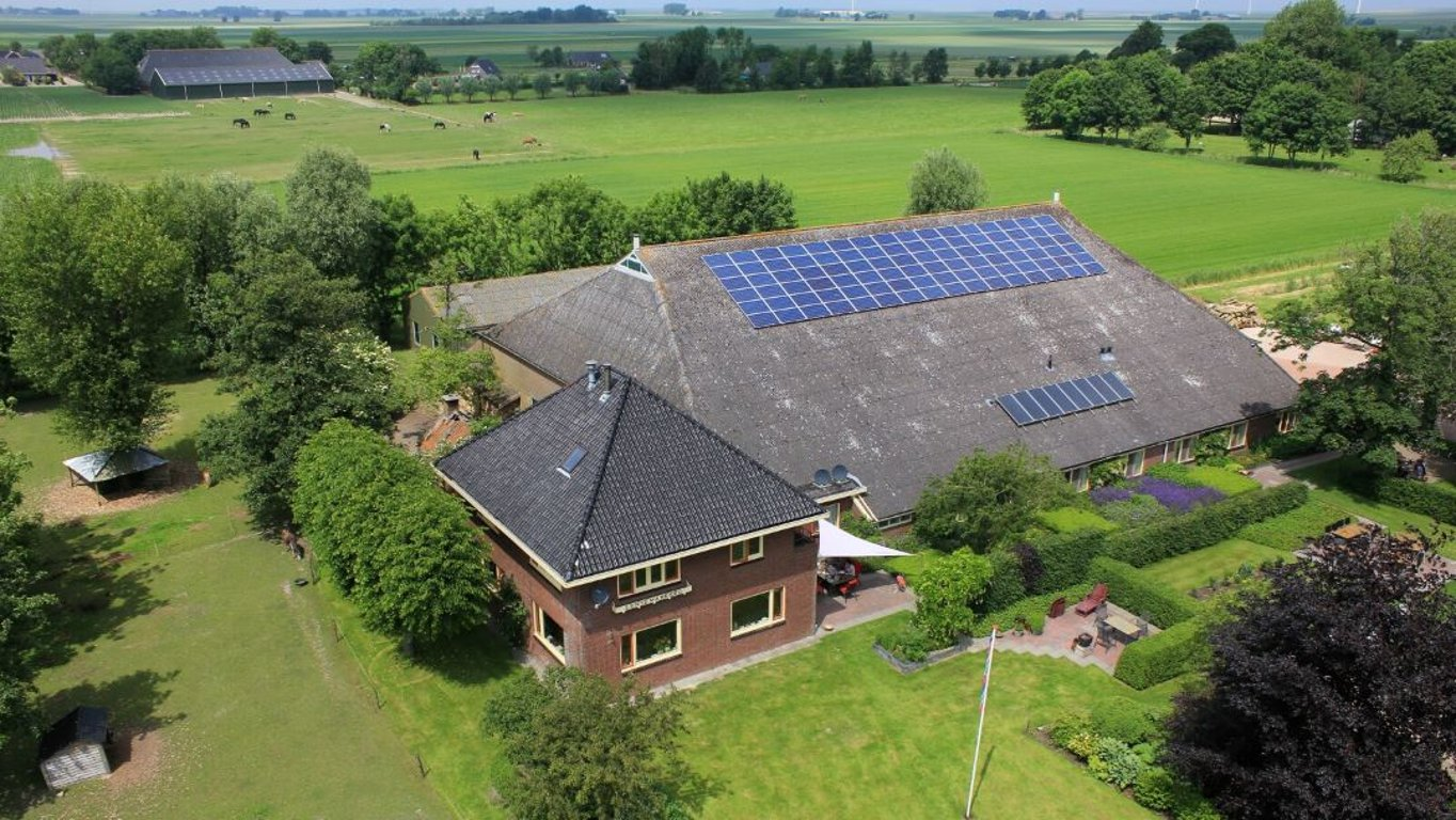 Big Farm House with Solar Power panels on the rooftop