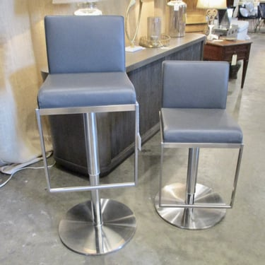 PAIR OF CHROME AND GREY LEATHER ADJUSTABLE BARSTOOLS